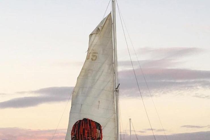 Lil Yachty's likeness painted on the sail of a yacht.