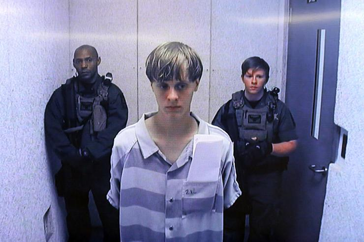 In this image from the video uplink from the detention center to the courtroom, Dylann Roof appears at Centralized Bond Hearing Court June 19, 2015 in North Charleston, South Carolina.