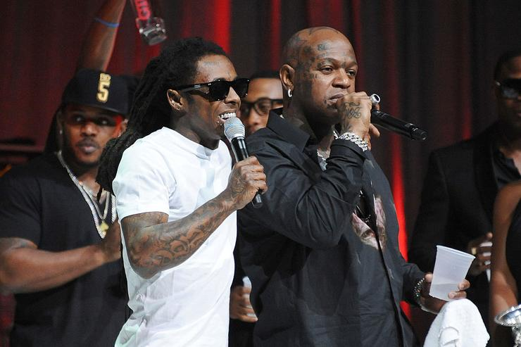 Lil Wayne and Birdman perform onstage at the 2013 BMI R&B/Hip-Hop Award at Hammerstein Ballroom on August 22, 2013 in New York City.