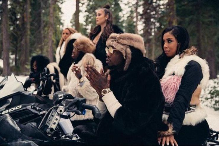 Migos pose at a video shoot.