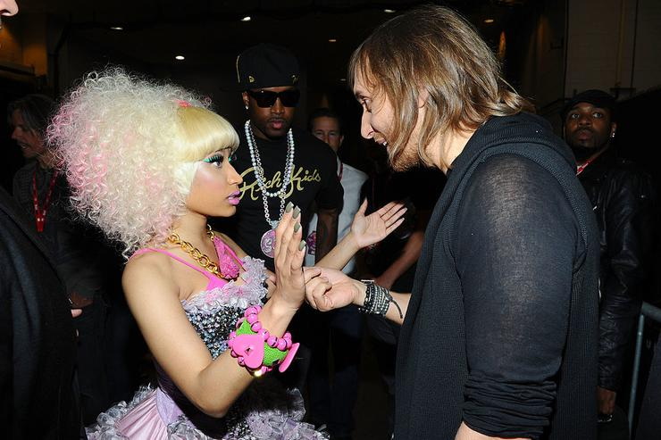 Nicki Minaj and DJ David Guetta pose backstage at the iHeartRadio Music Festival held at the MGM Grand Garden Arena on September 24, 2011 in Las Vegas, Nevada.