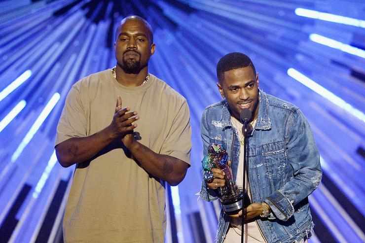 Kanye West and Big Sean accept the Video with a Social Message award for 'One Man Can Change The World' onstage during the 2015 MTV Video Music Awards at Microsoft Theater on August 30, 2015 in Los Angeles, California.