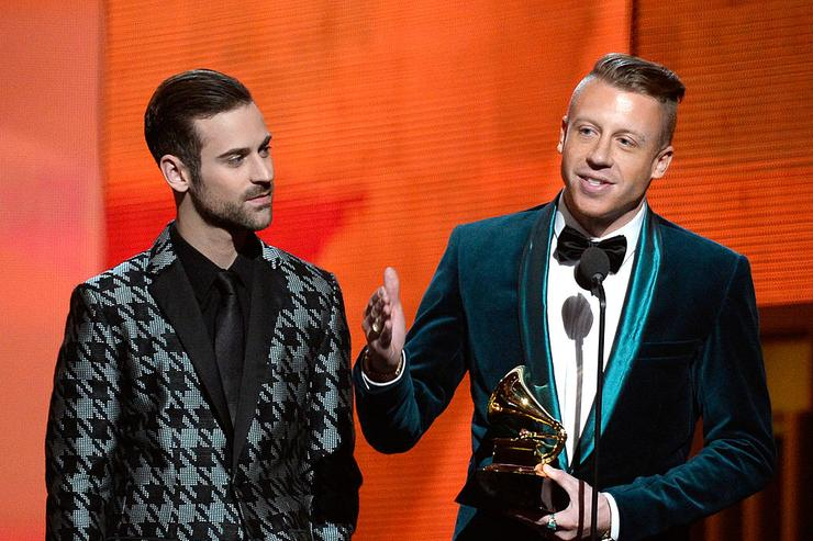 Ryan Lewis (L) and Macklemore accept the Best New Artist award onstage during the 56th GRAMMY Awards at Staples Center on January 26, 2014 in Los Angeles, California.