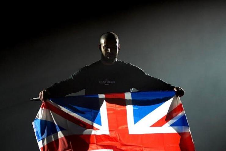 Drake carries the British flag.
