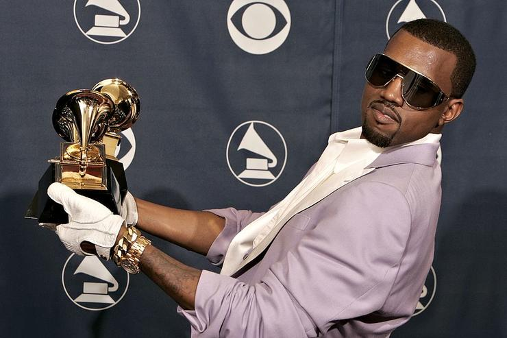 Kanye West with his awards for Best Rap Song, Best Rap Solo Performance and Best Rap Album in the press room at the 48th Annual Grammy Awards at the Staples Center on February 8, 2006 in Los Angeles, California.