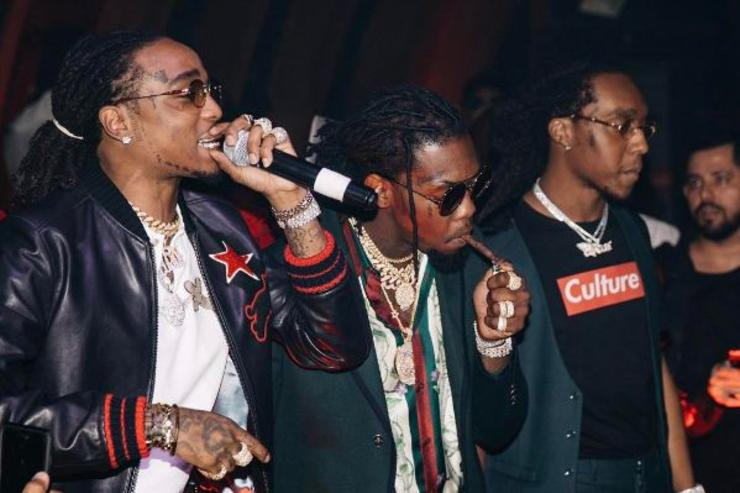 Migos perform at an event.