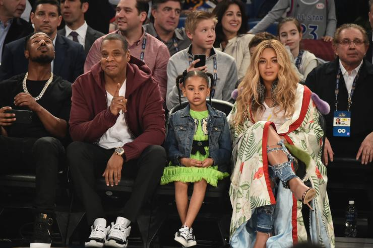 (L-R) Michael B. Jordan, Jay Z, Blue Ivy Carter and Beyoncé Knowles attend the 66th NBA All-Star Game at Smoothie King Center on February 19, 2017 in New Orleans, Louisiana.