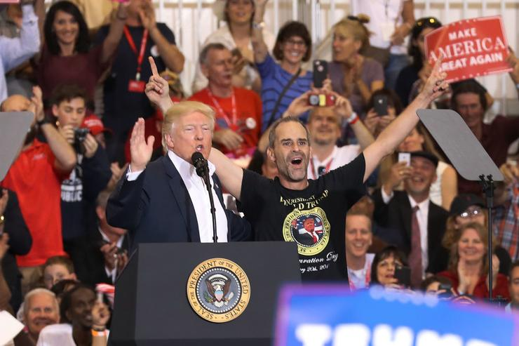 President Donald Trump introduces Gene Huber on stage to speak during a campaign rally at the AeroMod International hangar at Orlando Melbourne International Airport on February 18, 2017 in Melbourne, Florida.