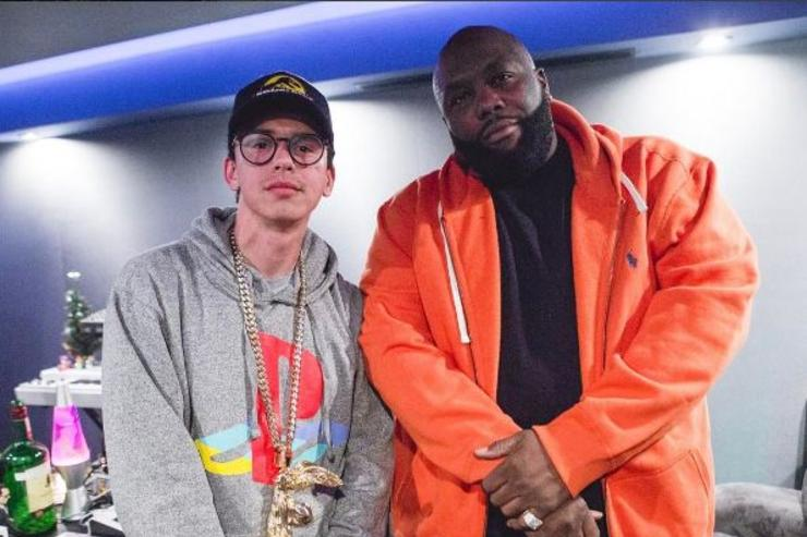 Logic and Killa Mike pose for a photo in the studio.