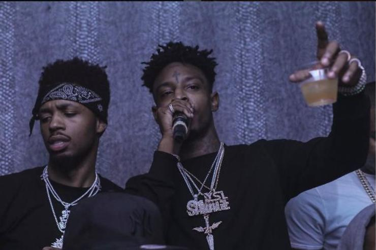Metro Boomin and 21 Savage party at a social event.