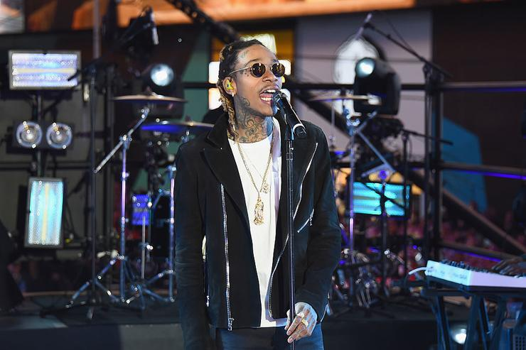 "Wiz Khalifa performs ""See You Again"" on stage with singer Charlie Puth at the Dick Clark's New Year's Rockin' Eve with Ryan Seacrest 2016 on December 31, 2015 in New York City."