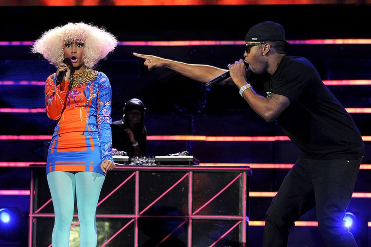 Nicki Minaj (L) and Safaree Samuel perform onstage during 'VH1 Divas Salute the Troops' presented by the USO at the MCAS Miramar on December 3, 2010 in Miramar, California.