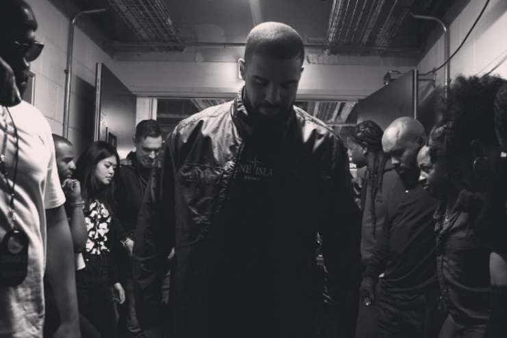 Drake meets with his team.