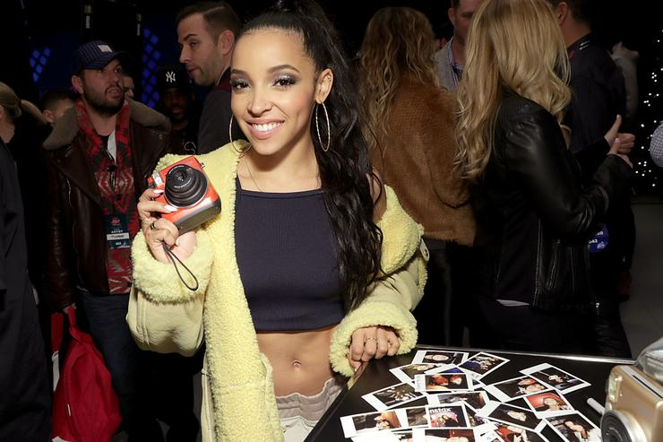 Tinashe poses with Fujifilm Instax Mini during Z100's artist gift lounge during Jingle Ball 2016 at Madison Square Garden on December 9, 2016 in New York City.