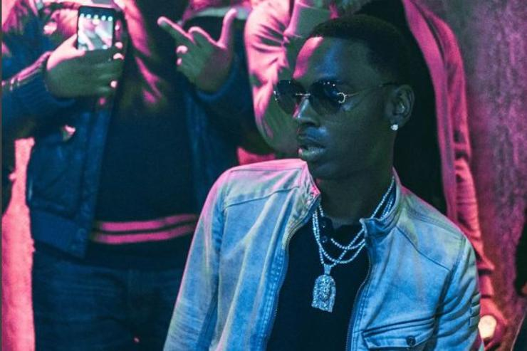 Young Dolph poses for a photo at a night club.