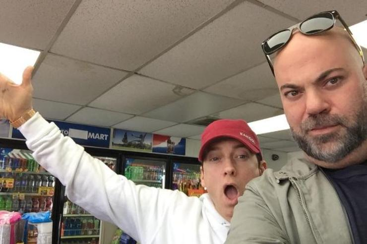 Eminem and Paul Rosenberg make a selfie in a corner store.