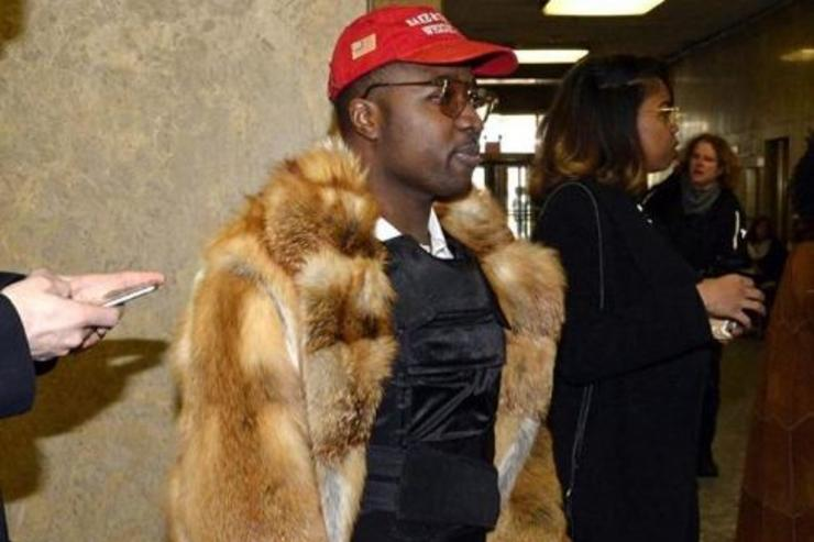 Troy Ave leaves court wearing a bulletproof vest under his fur coat.