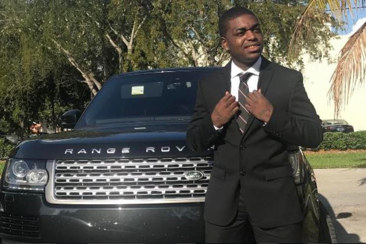 Kodak Black leans on his truck the day of his arrest in February.
