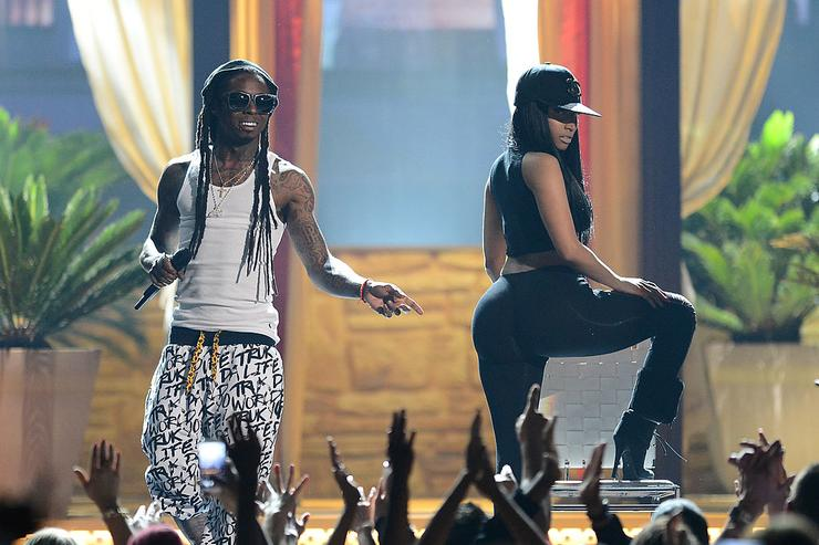 Lil Wayne (L) and recording artist Nicki Minaj perform onstage during the 2013 Billboard Music Awards at the MGM Grand Garden Arena on May 19, 2013 in Las Vegas, Nevada.