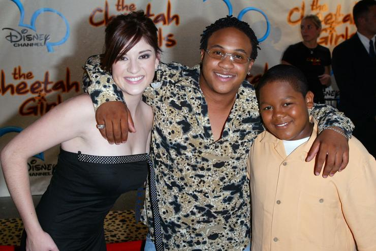 Anneliese van der Pol, Orlando Brown and Kyle Orlando Massey of the shot 'That's So Raven,' attend the premiere of Disney Channel's 'The Cheetah Girls' at La Guardia High School August 5, 2003 in New York City.