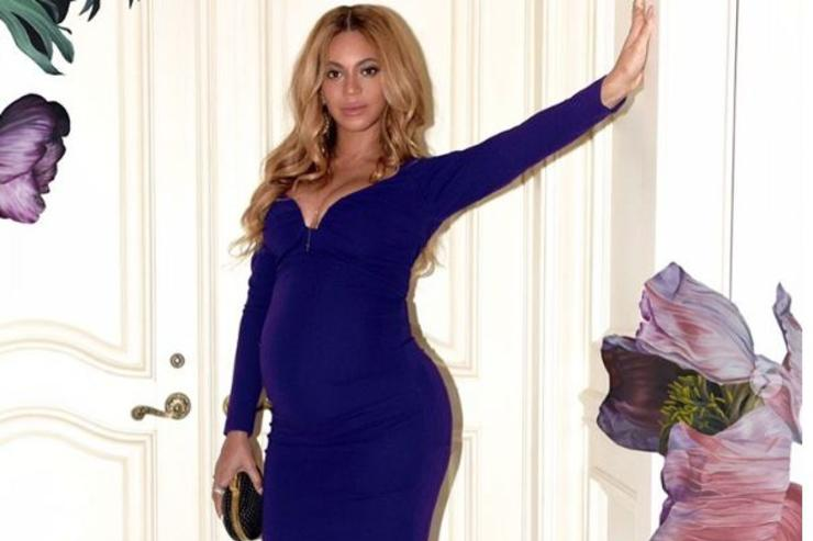 Beyonce poses for a photo.