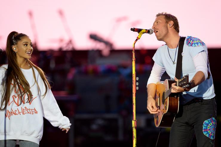 Ariana Grande performs with Chris Martin from Coldplay at One Love Manchester Concert