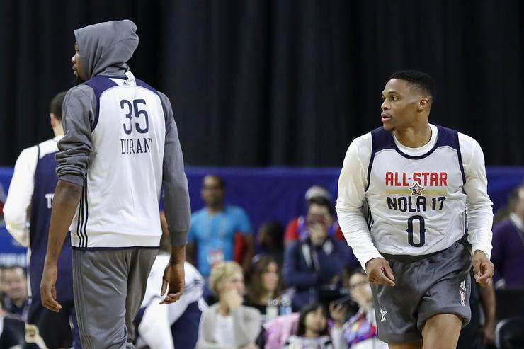 Kevin Durant #35 of the Golden State Warriors (L) and Russell Westbrook #0 of the Oklahoma City Thunder attend practice for the 2017 NBA All-Star Game